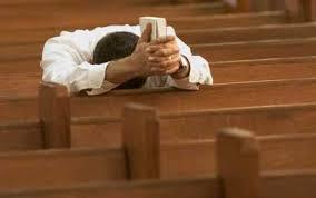 Bowed head in church